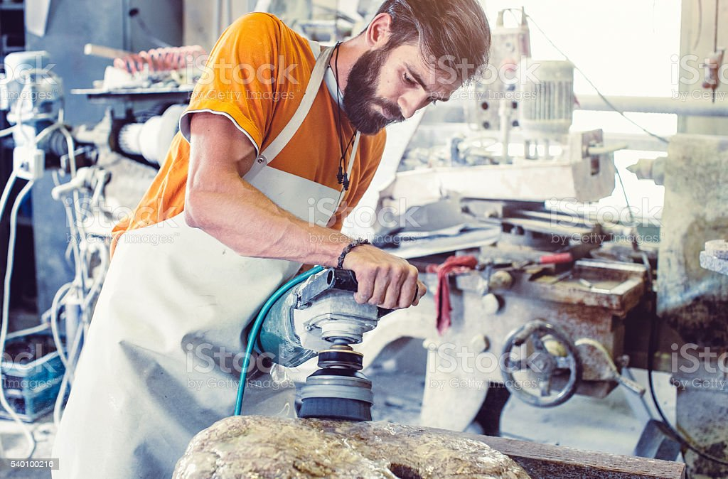 Stonecutter at work stock photo