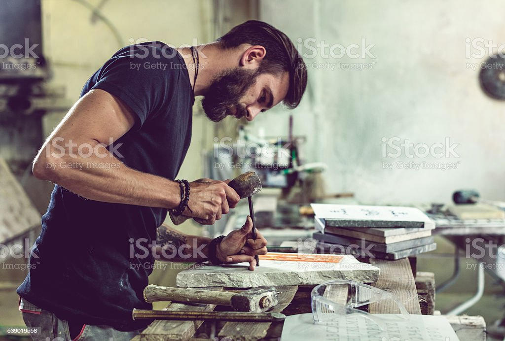Stonecutter portrait at work stock photo