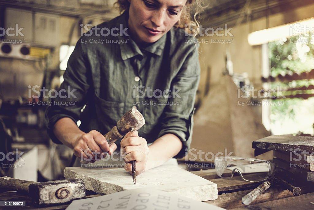 Stonecutter woman portrait stock photo