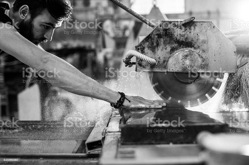 Stonecutter working stock photo