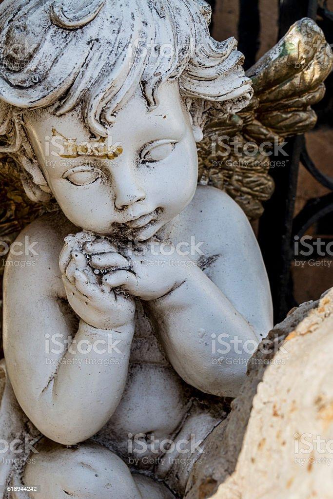 Stoned Cherub stock photo