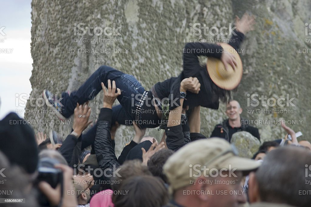 Stonehenge, England - June 21st, 2009: Summer Solstice Crowdsurfing stock photo