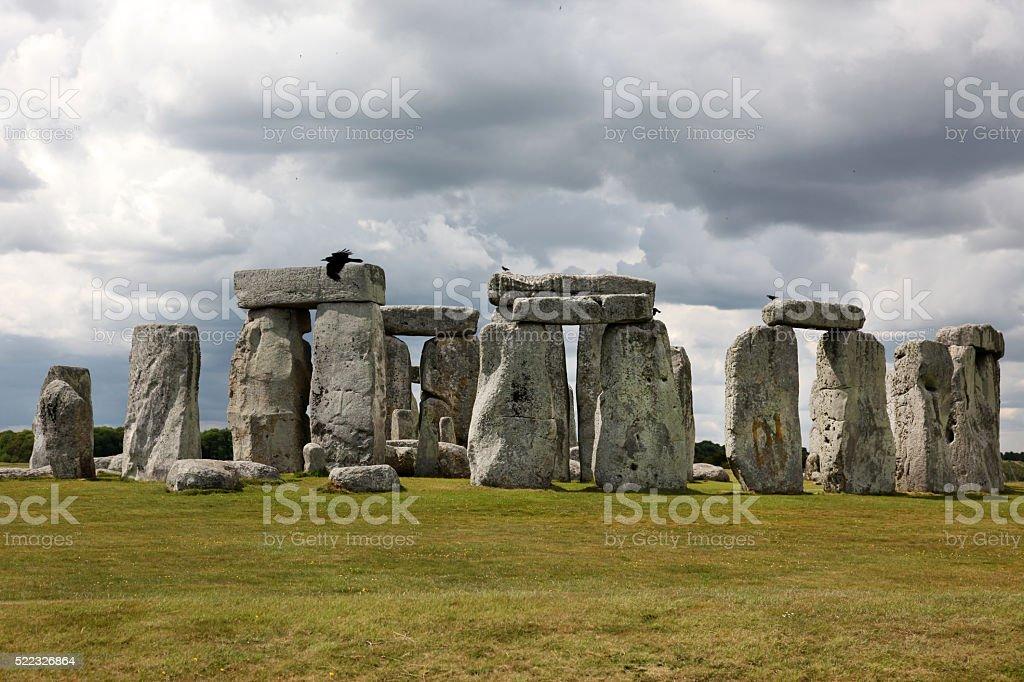 Stonehenge historic site on green grass stock photo