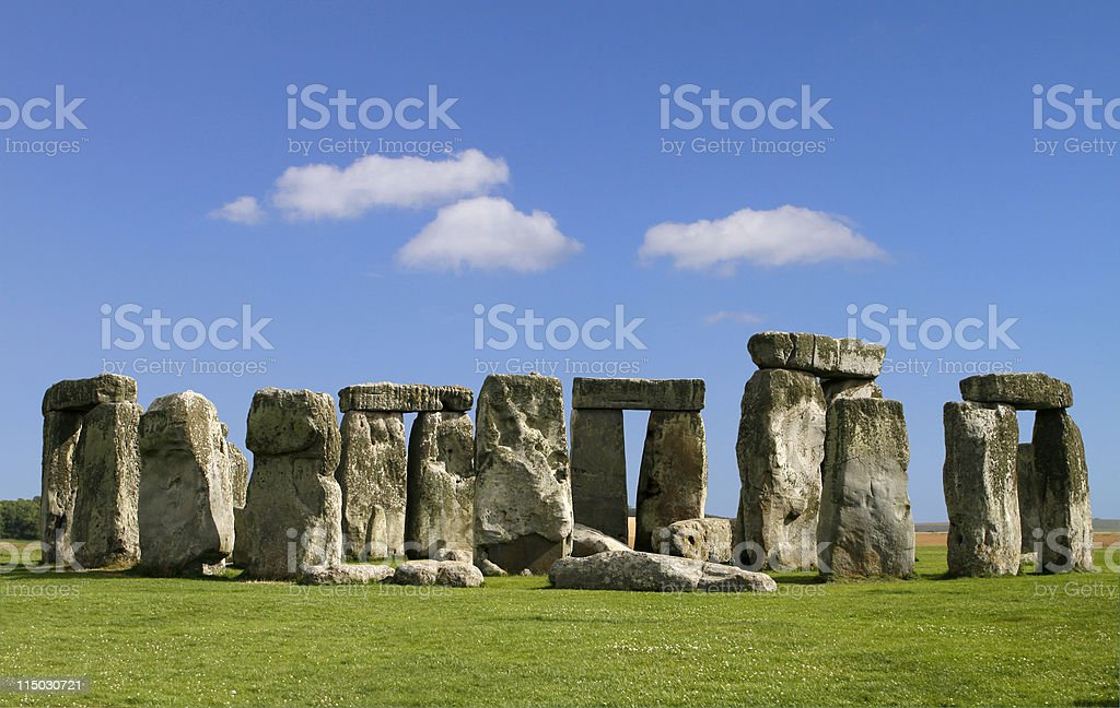 Stonehenge with green grass and blue sky stock photo