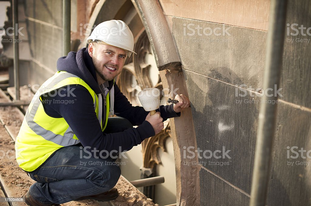 stonemason on church restoration stock photo