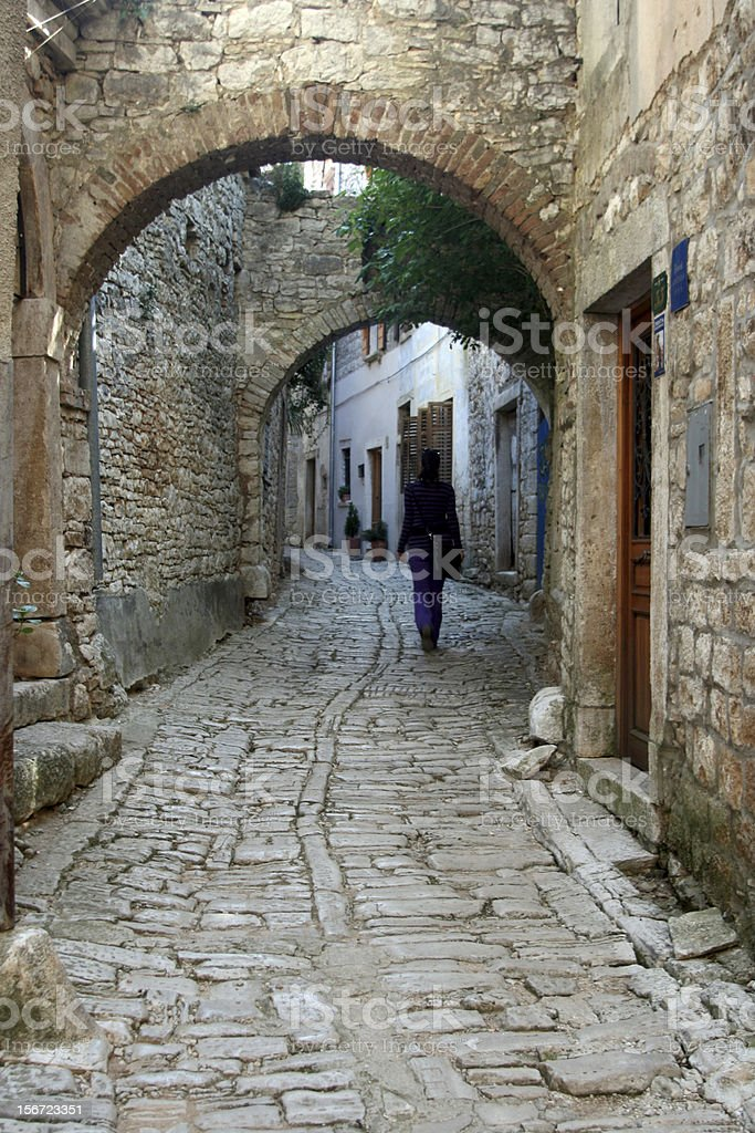Stonepaved street and stonemade arches in Bale royalty-free stock photo