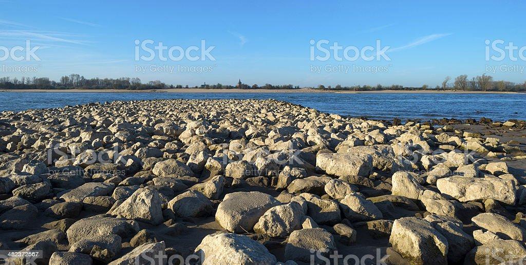 Stones along the shore of a river stock photo