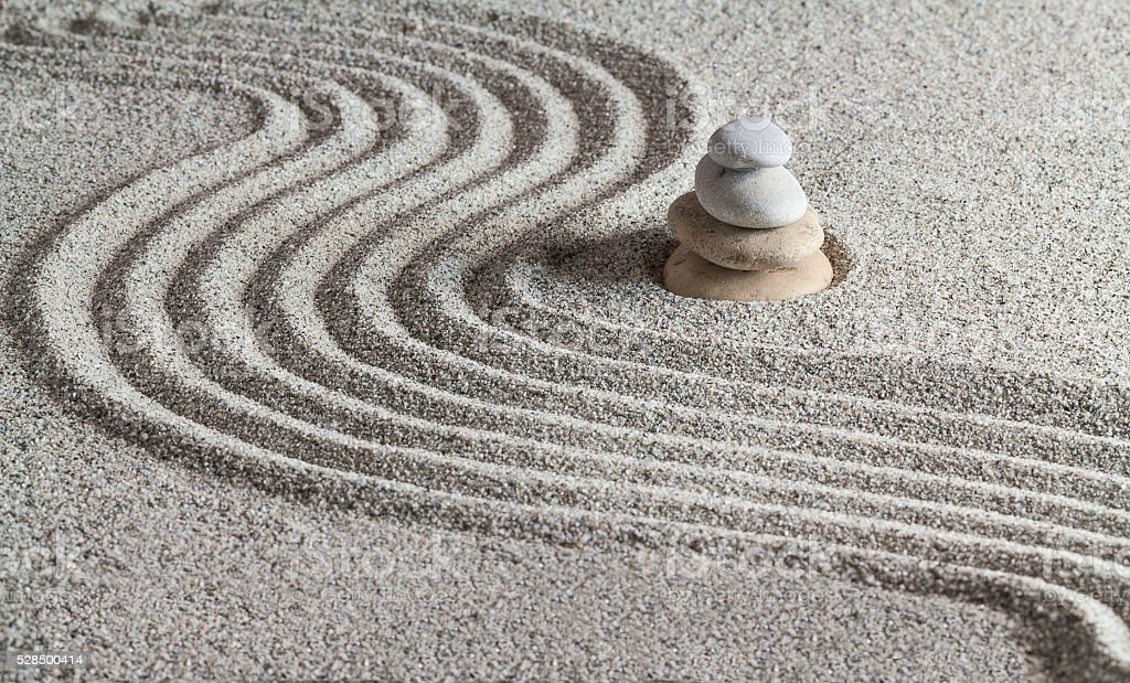 Stones and a line on the sand. stock photo