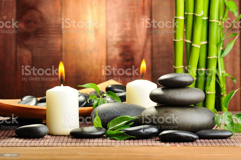 Stones and candles spa concept royalty-free stock photo