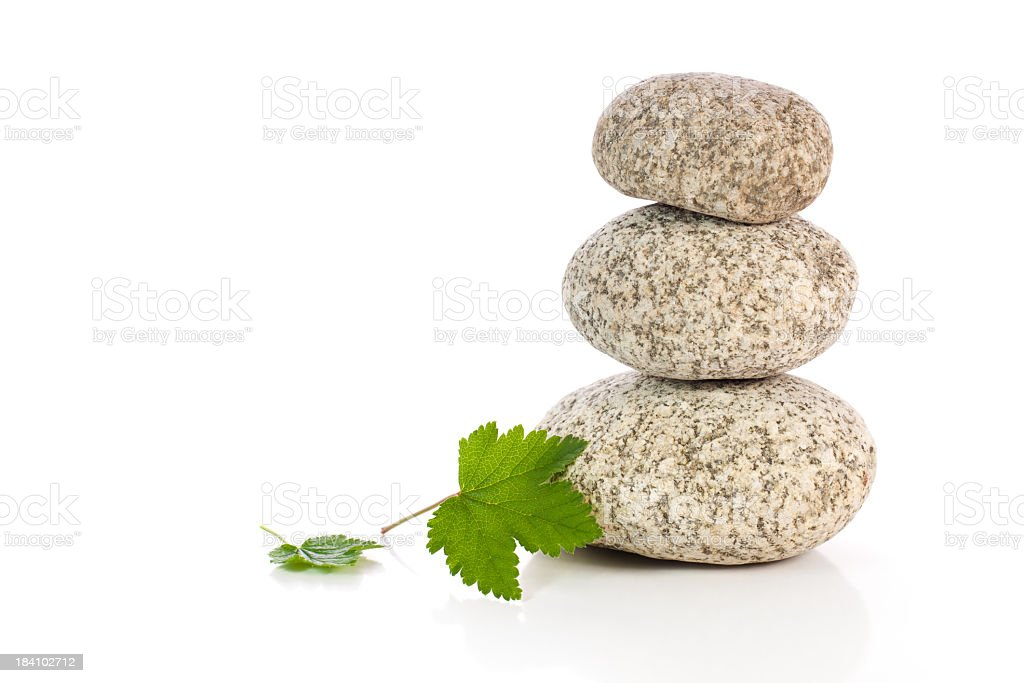 Stones and herbal leafs royalty-free stock photo