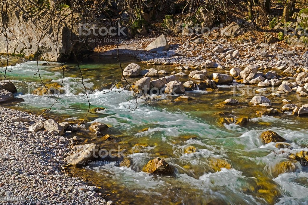 stones and mountain river stock photo
