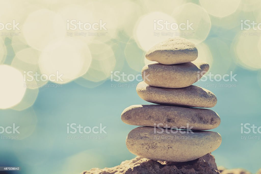 Stones balance at the beach, stack over blue sea stock photo