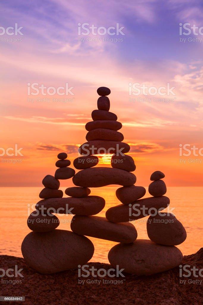 Stones balance on a background of sea sunset. Concept of harmony and balance stock photo