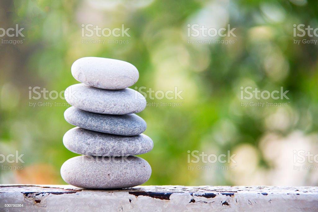 Stones balance vintage pebbles stack background stock photo