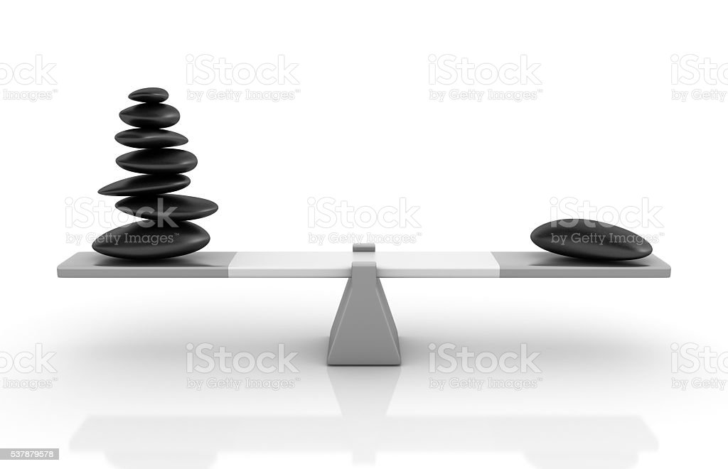 Stones Balancing on a Seesaw stock photo