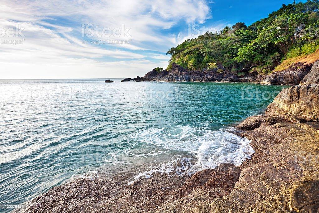 Stones beach before sunset. stock photo