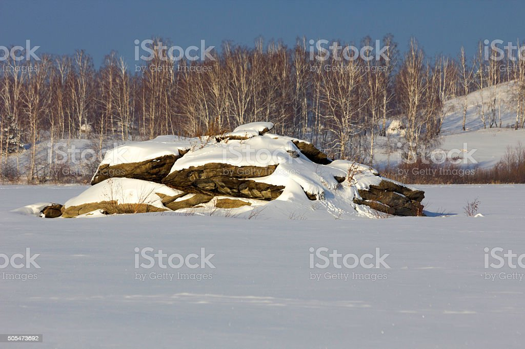 Stones covered with snow stock photo