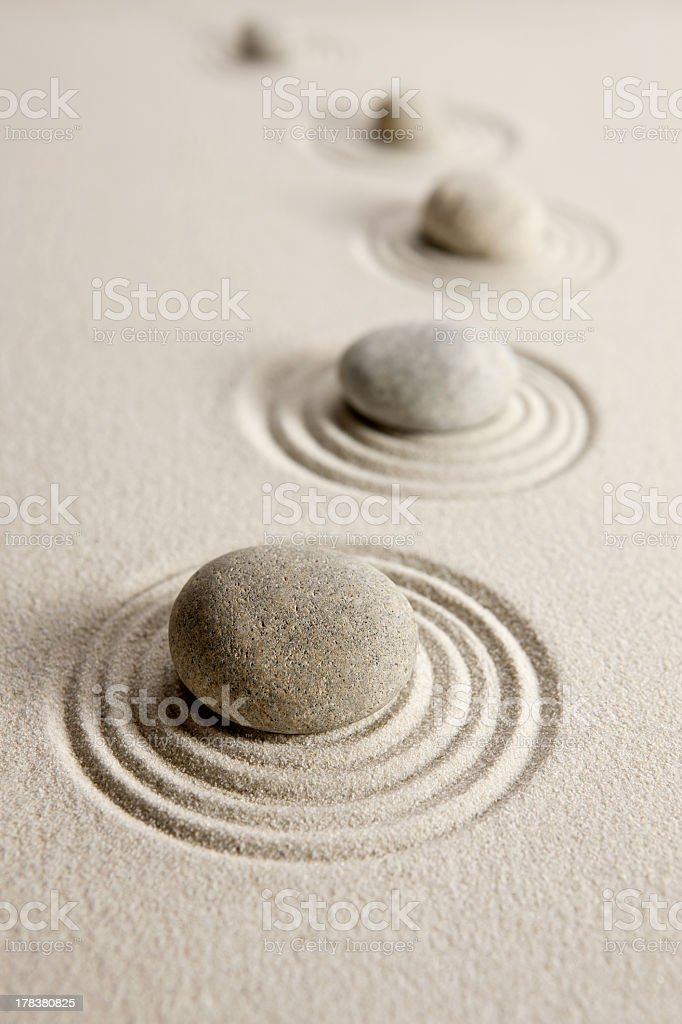 Stones in a line in the sand in a pattern stock photo