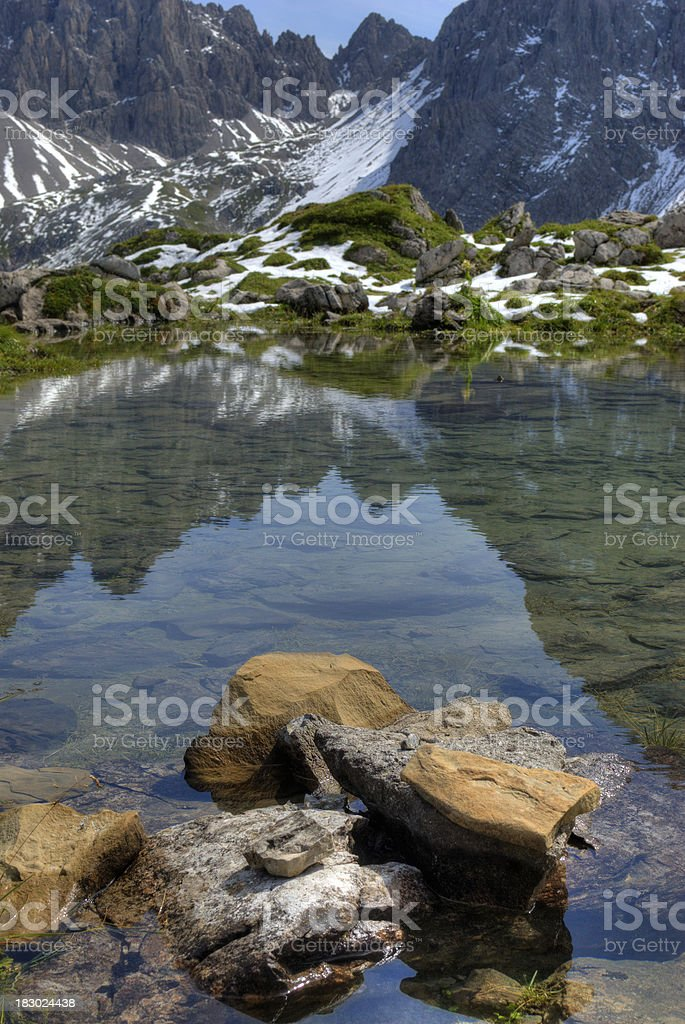 Stones in a little lake royalty-free stock photo