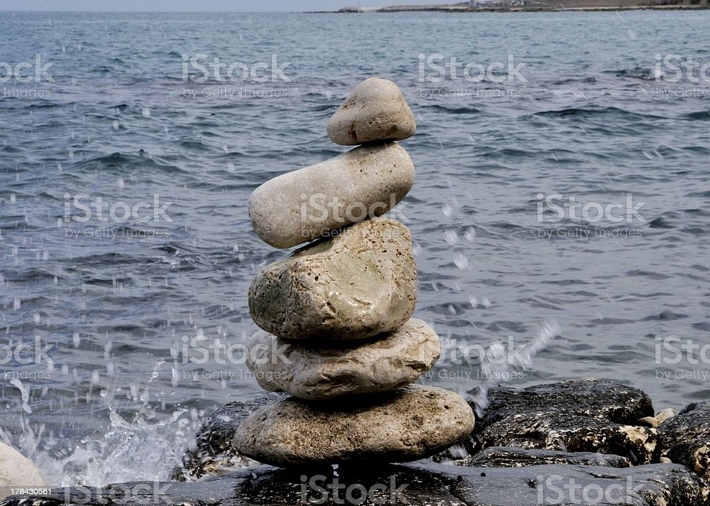 Stones in balance on the sea royalty-free stock photo