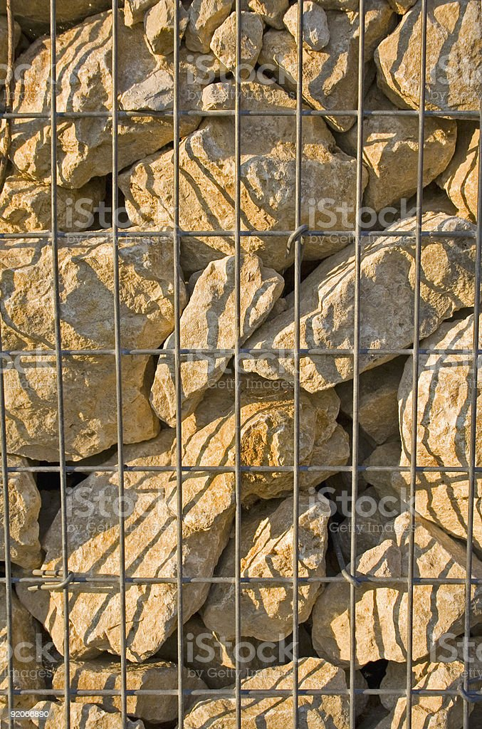 stones in cage royalty-free stock photo