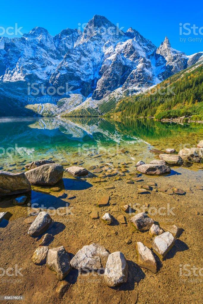 Stones in Morskie Oko lake in autumn season, Tatra Mountains, Poland stock photo