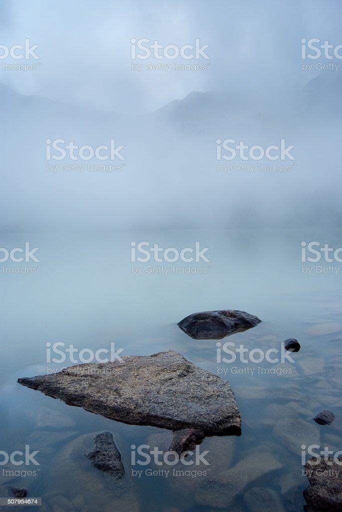 Stones in mountain lake stock photo