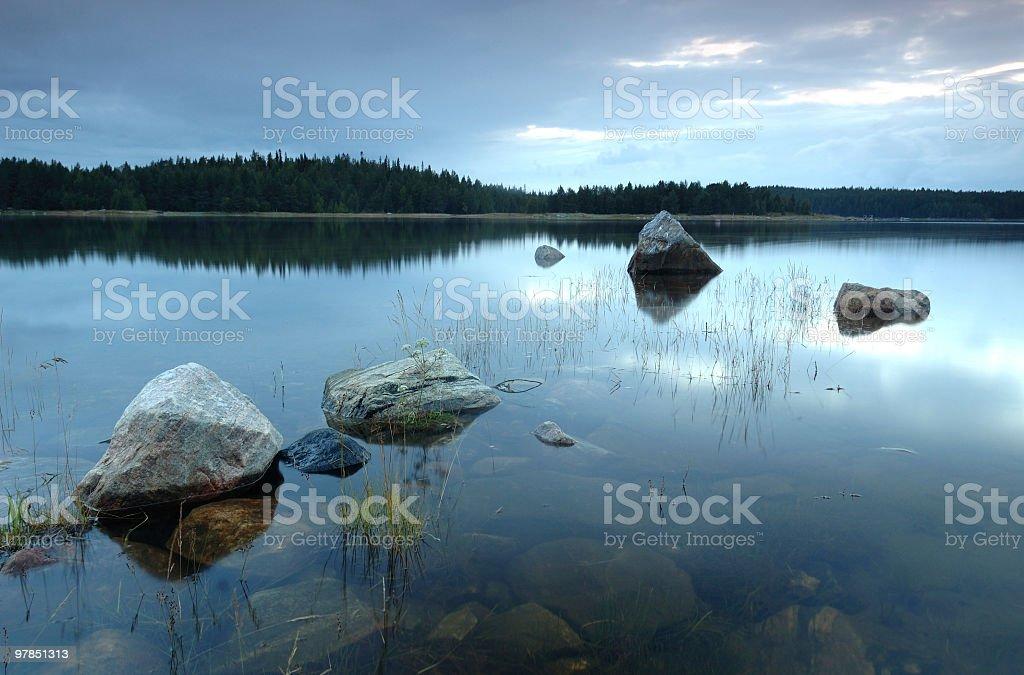Stones in the blue lake.jpg stock photo