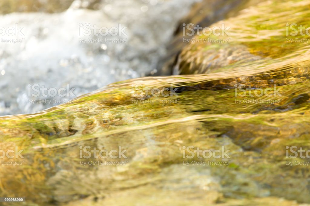 stones in the mountain river stock photo