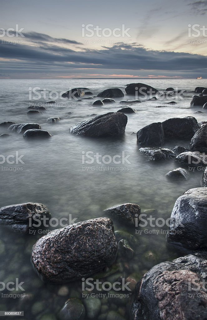 Stones in the sea after sunset royalty-free stock photo