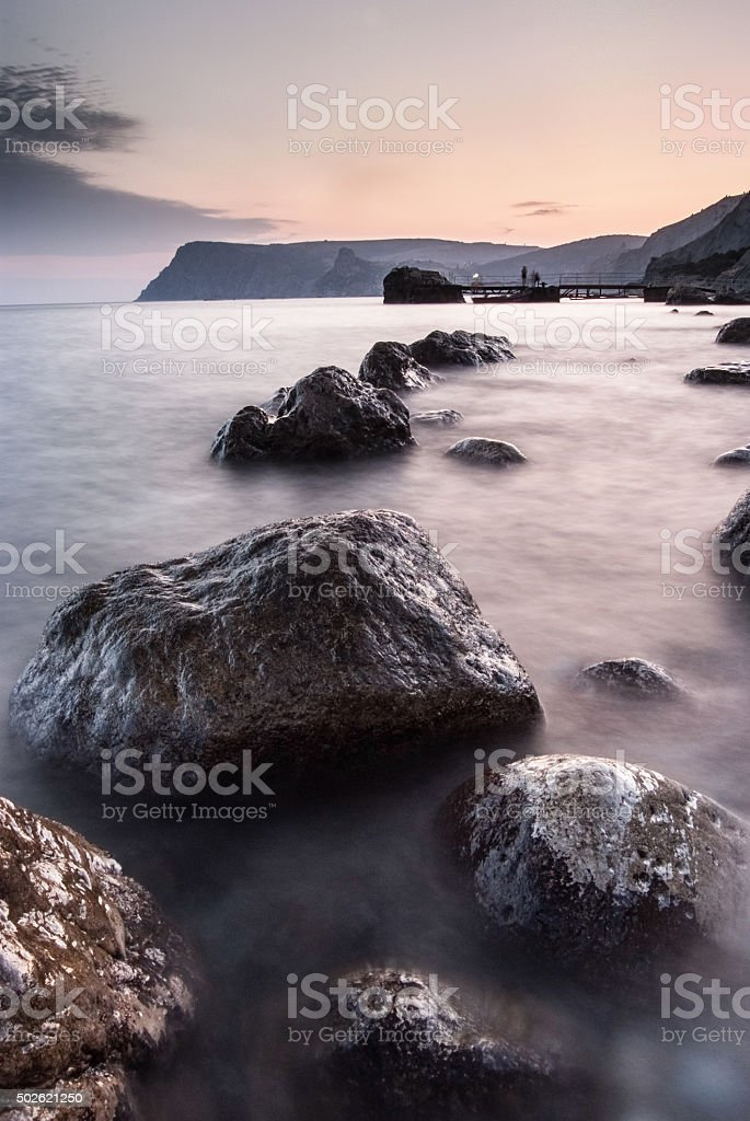 Stones in the sea on a long exposure stock photo