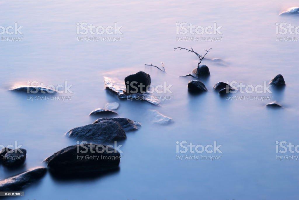 Stones in water stock photo