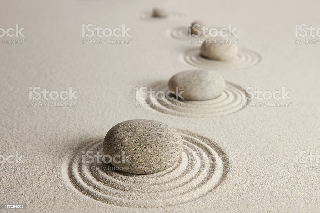 Stones in white stand with circles around them stock photo