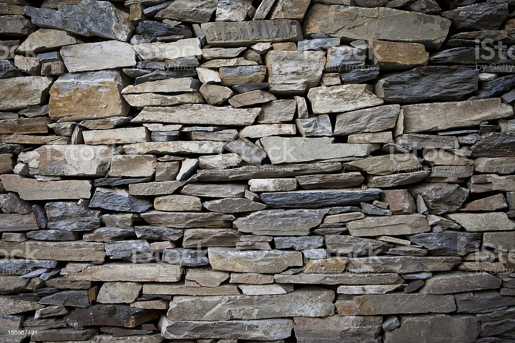 Stones layered to form a wall royalty-free stock photo