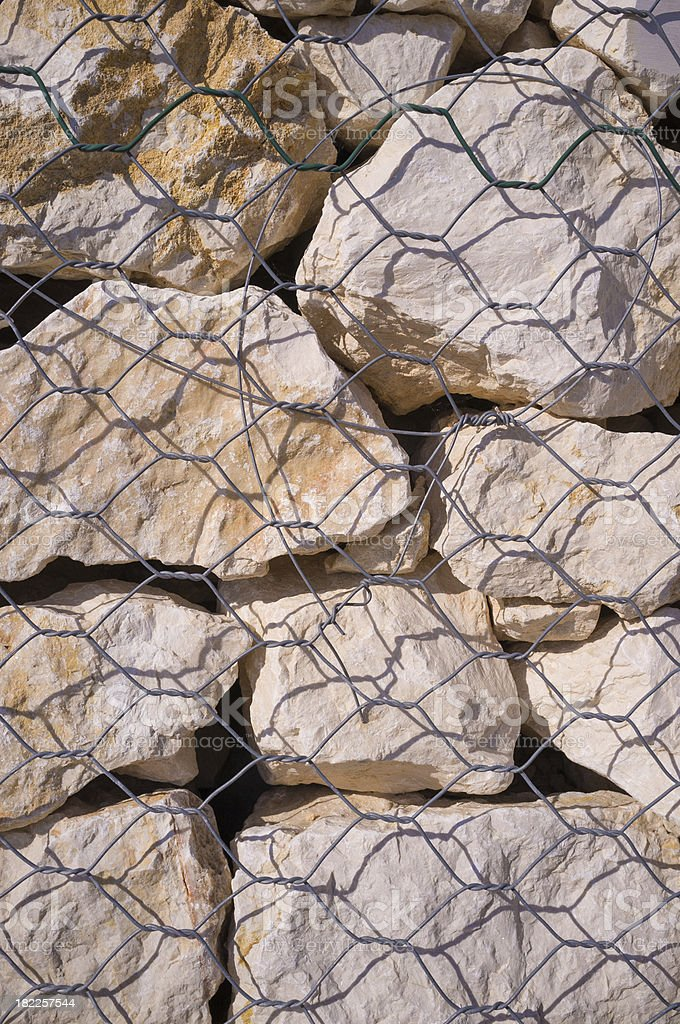 Stones of a gabion wall royalty-free stock photo