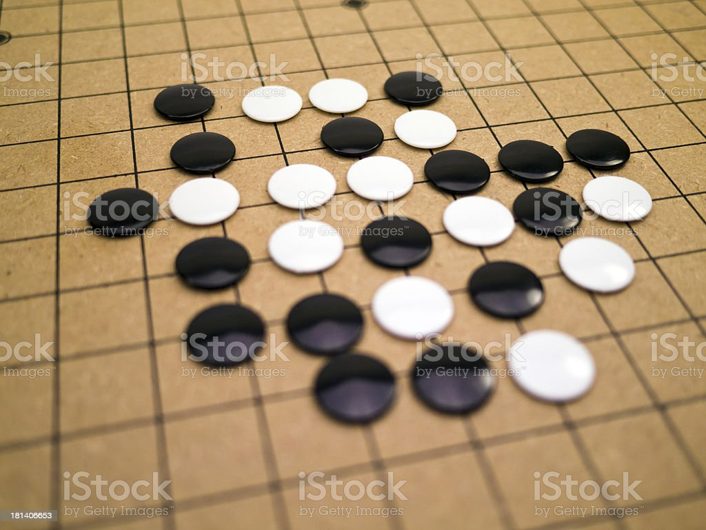 stones on a Go board royalty-free stock photo