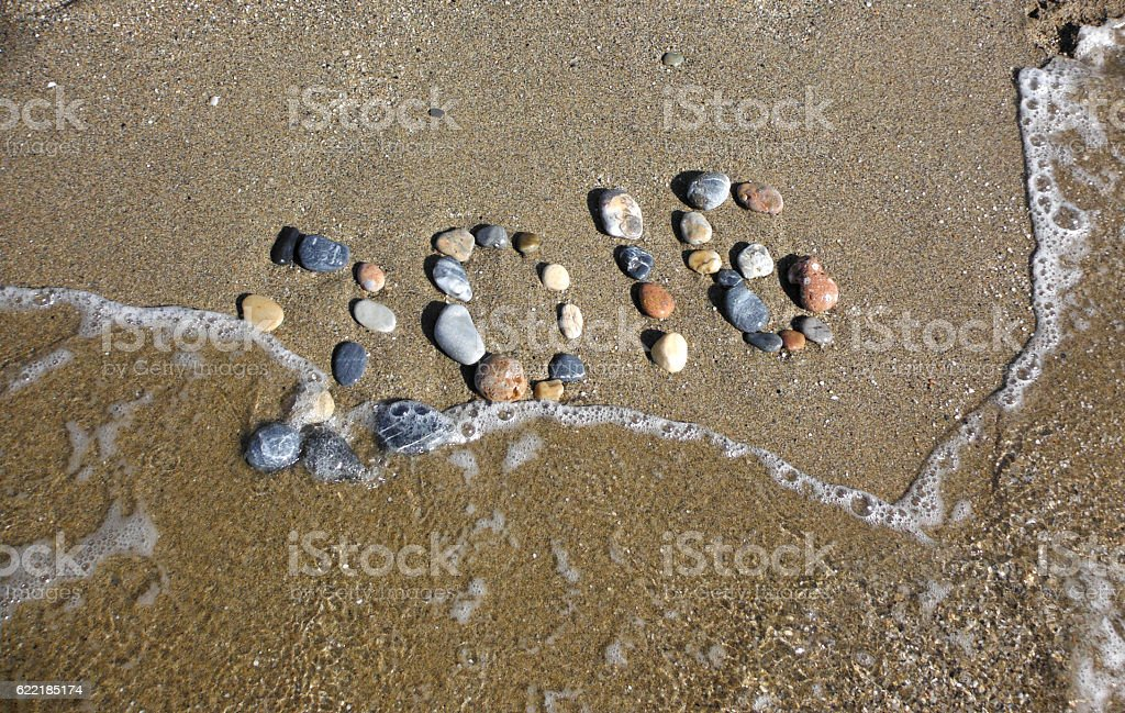 stones on the sand stock photo