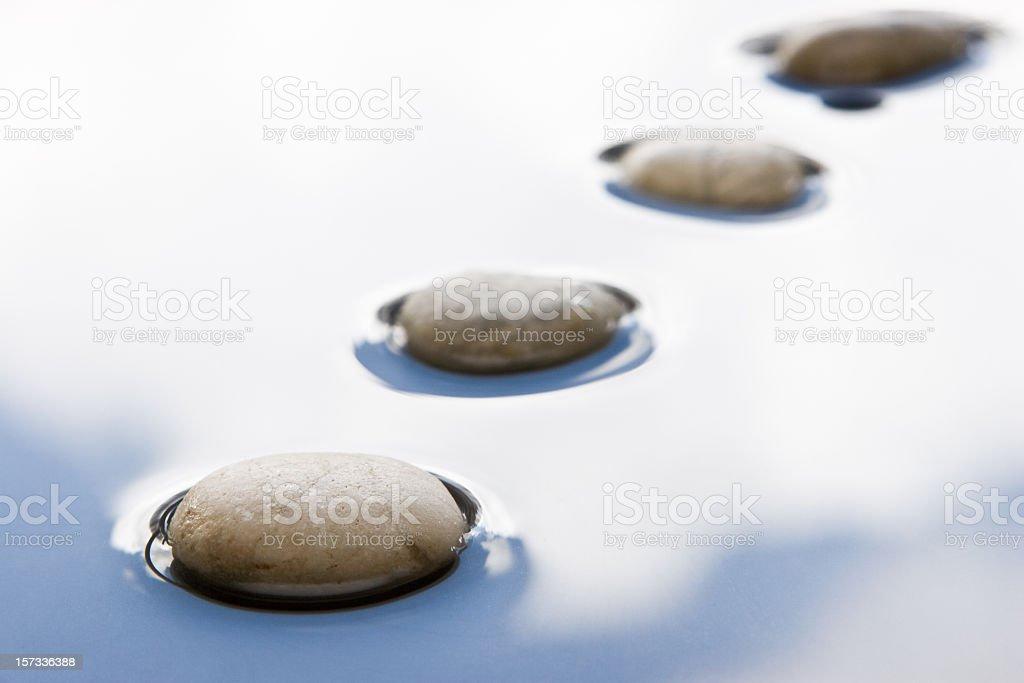 Stones on water stock photo