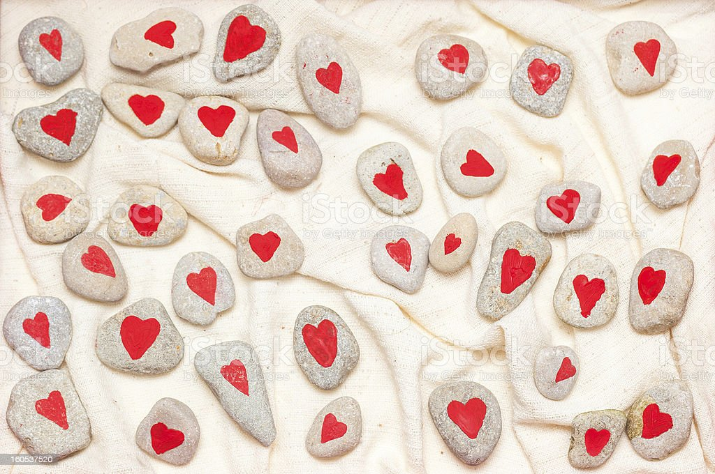 stones painted with red hearts royalty-free stock photo