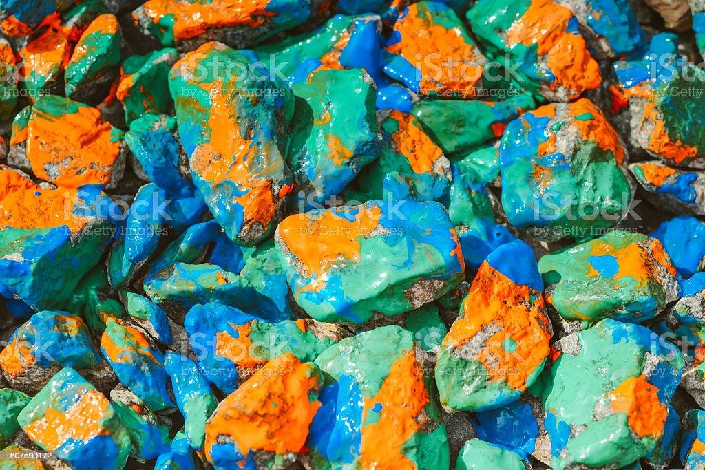 stones rubble closeup painted color ink stock photo