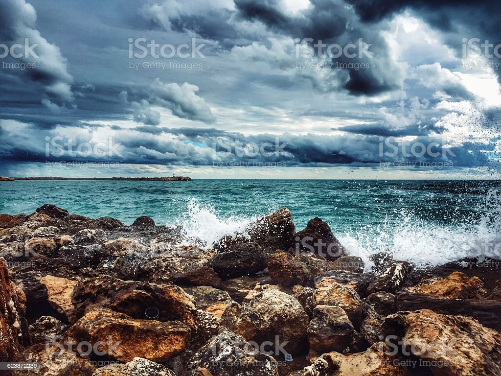 Stones sea and clouds stock photo