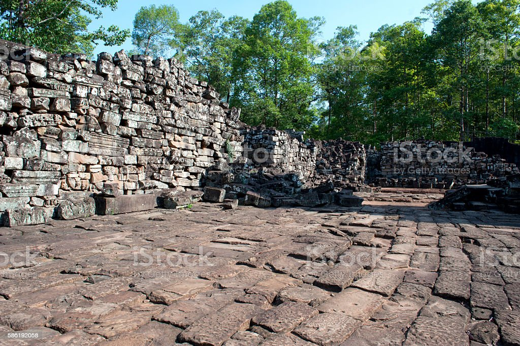 Stones wall and road of Bayon Temple in Angkor Thom stock photo