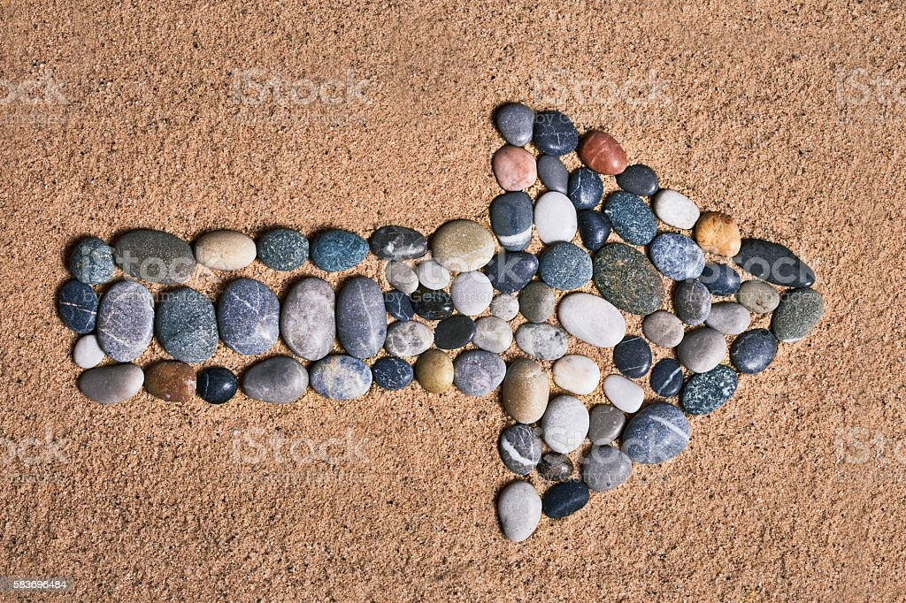 stones with directional signs stock photo