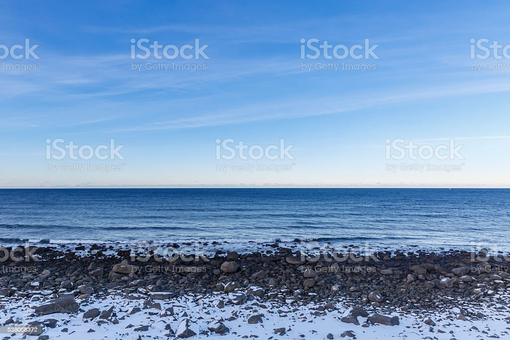 Stony shoreline on Vestvagoy Island stock photo