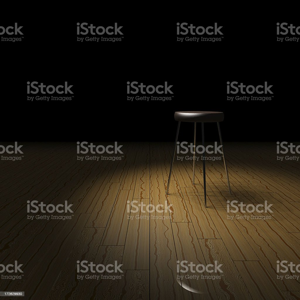 Stool in spotlight royalty-free stock photo