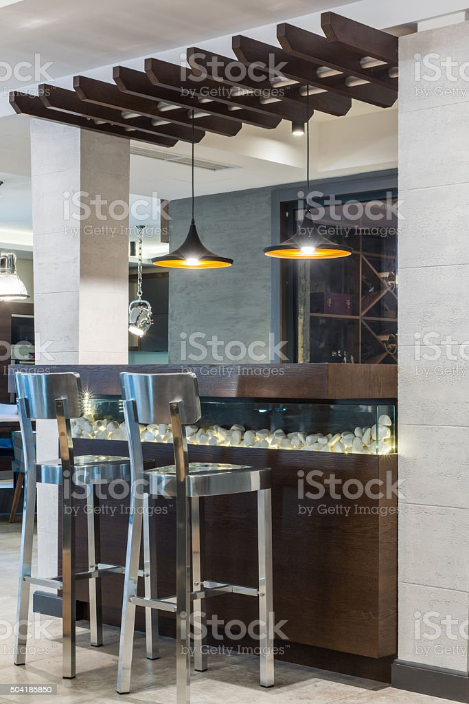 Stools and kitchen island in modern home interior stock photo