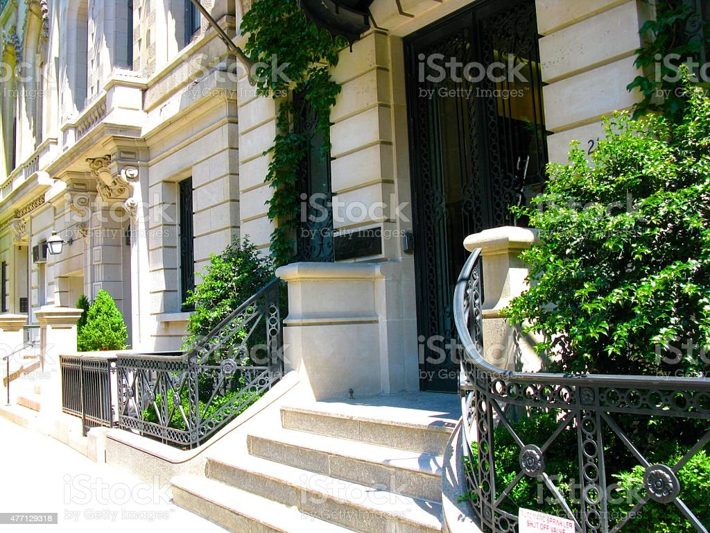 Stoop of New York City townhouse mansion stock photo