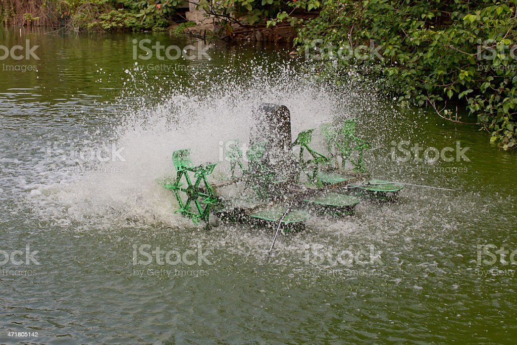 Stop action of water and aerator turbine in pool stock photo