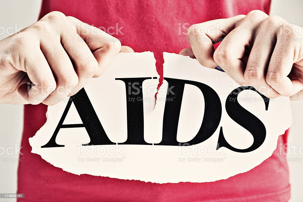 Stop AIDS! Female hands rip up sign royalty-free stock photo