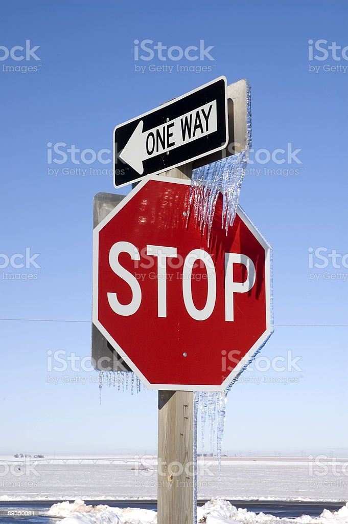 Stop and One Way Signs with Icicles royalty-free stock photo